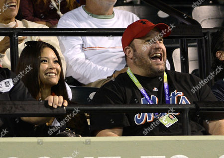 Us Actor and Comedian Kevin James (r) Sits with His Wife Steffiana De La Cruz (l) During the Eugenie Bouchard of Canada Against Maria Sharapova of Russia Match at the Sony Open Tennis Tournament in Miami Florida Usa 22 March 2013 United States Miami