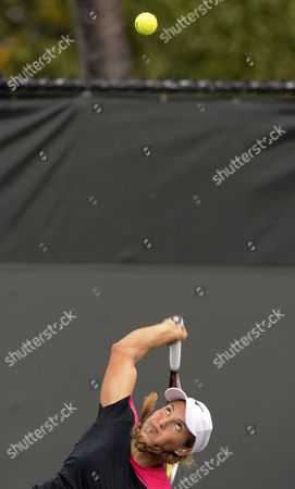 Yulia Putintseva of Kazakhstan Serves the Ball to Nina Bratchikova of Russia During Their Qualifying Match at the Sony Open Tennis Tournament in Miami Florida Usa 19 March 2013 United States Miami