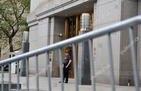 A Court Officer Stands Guard Outside Federal Court on 06 October 2012 in New York After Terror Suspect Radical Islamist Preacher Abu Hamza Al-masri Appeared Before Us Judge Frank Maas After Being Extradited From Britain a Department of Justice Statement Said Hamza Would Face Terrorism Charges Over a Kidnapping in 1998 in Yemen the Establishment of a Terrorist Training Camp in the United States and For 'Facilitating Violent Jihad in Afghanistan ' Hamza is Charged with Two Other Suspects Khaled Al-fawwaz and Adel Abdul Bary United States New York