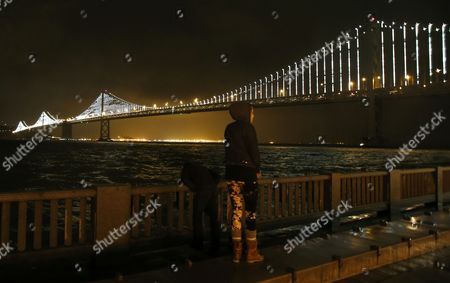 A Woman Looks at the Newly Lit Up San Francisco Bay Bridge After the Official Bay Lights Grand Lighting in San Francisco California Usa 05 March 2013 the Bay Lights is the World's Largest Led Light Sculpture It Stretches 1 8 Miles (2 89km) Wide and is 500 Feet (152 4m) High the Light Exhibit Has 25 000 White Led Lights That Are Individually Programmed by Artist Leo Villareal to Create a Never-repeating Display Across the Bay Bridge's West Span Through 2015 United States San Francisco