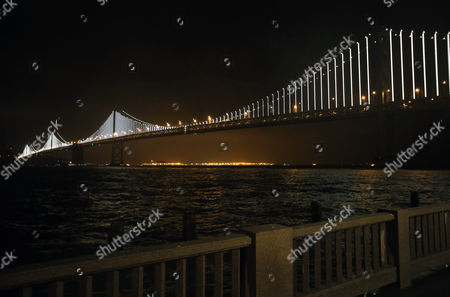 The San Francisco Bay Bridge is Lit Up During the Official Bay Lights Grand Lighting in San Francisco California Usa 05 March 2013 the Bay Lights is the World's Largest Led Light Sculpture It Stretches 1 8 Miles (2 89km) Wide and is 500 Feet (152 4m) High the Light Exhibit Has 25 000 White Led Lights That Are Individually Programmed by Artist Leo Villareal to Create a Never-repeating Display Across the Bay Bridge's West Span Through 2015 United States San Francisco