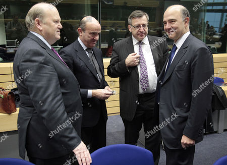 (l-r) Irish Finance Minister Michael Noonan Spanish Minister of Economy Luis De Guindos Belgian Finance Minister Steven Vanackere and French Finance Minister Pierre Moscovic at the Start of a Eurogroup Meeting at the Eu Headquarters in Brussels Belgium 13 December 2012 Eurozone Finance Ministers Met For the Fifth Week in a Row to Tackle the Thorny Issue of Aid to Greece But Were Expected This Time to Give the Final Go-ahead For a Long-awaited Bailout Tranche Belgium Brussels