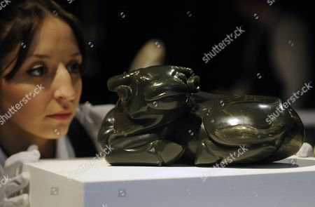 A Sotheby's Auction House Staff Looks Over a Rare Khotan Green Jade Water Buffalo From the Qing Dynasty at Sotheby's in London Britain 02 November 2012 the Water Buffalo Estimated at 400 000-600 000 Euros is Up For Auction in London on 07 November United Kingdom London