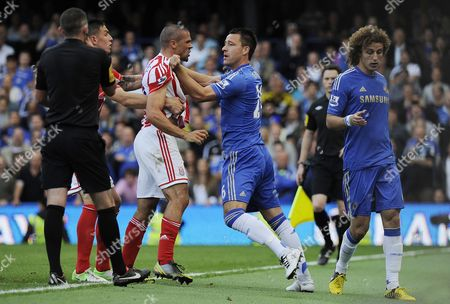 Chelsea's John Terry Gets Into an Altercation with Stoke City's Johnathan Walters (l) Following David Luiz's Harsh Tackle on Walters During an English Premier League Soccer Match at Stamford Bridge in London Britain 22 September 2012 Dataco Terms and Conditions Apply Http//www Epa Eu/downloads/dataco-tcs Pdf United Kingdom London