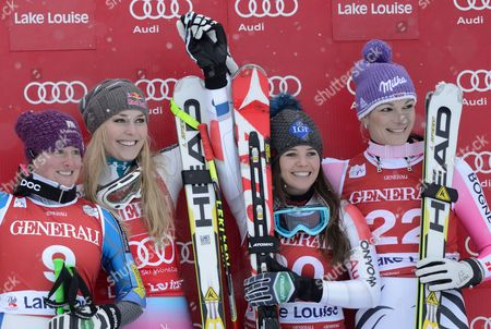 (l-r) Second Placec Stacey Cook of the Usa; Winner Lindsey Vonn of the Usa and Tina Weirather of Liechtenstein and Maria Hoefl-riesch of Germany Tied For Third Pose on the Podium After the Alpine Skiing World Cup Women's World Cup Downhill Race in Lake Louise Alberta Canada 30 November 2012 Canada Lake Louise