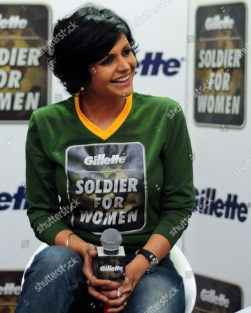 Bollywood Actress and Television Presenter Mandira Bedi Smiles During a 'Soldier For Women' Campaign Event in the Southern Indian City of Bangalore 05 March 2013 the Nation-wide Campaign 'Soldier For Women' Initiated by Men's Personal Care Brand Gillette India Encourages Men to Stand Up For Women in the Wake of the Recent Public Uproar About Crimes Against Women in the Country India Bangalore
