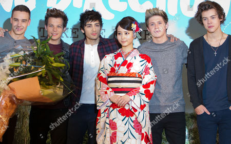 Stock Photo of (l-r) Liam Payne Louis Tomlinson Zayn Malik Niall Horan and Harry Styles of English-irish Pop Boy Band One Direction Poses on Stage with Japanese Actress Maki Horikita Wearing a Japanese Traditional Kimono During a Press Conference to Promote Their Second Latest Album 'Take Me Home' in Tokyo Japan 18 January 2013 Japan Tokyo