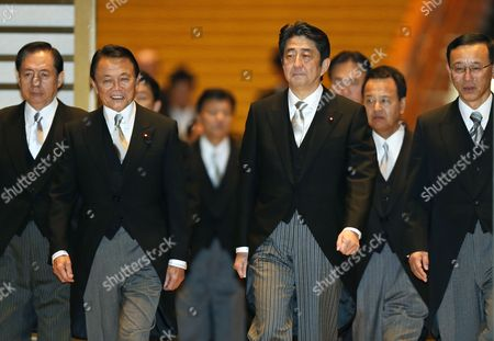 Newly Appointed Japanese Prime Minister Shinzo Abe Smiles with Former Prime Minister and Newly Appointed Finance Minister Taro Aso (2nd L) and New Justice Minister Sadakazu Tanigaki (r) After Being Attested by Emperor Akihito at the Imperial Palace in Tokyo Japan 26 December 2012 Japan Tokyo