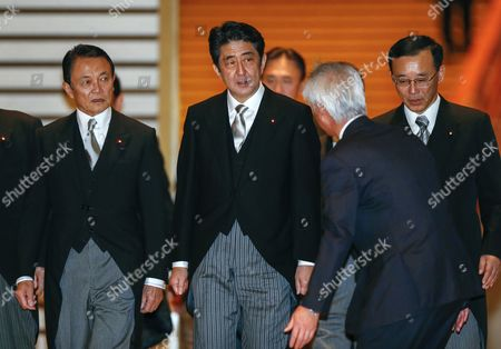 Newly Appointed Japanese Prime Minister Shinzo Abe (c) is Escorted by an Imperial Official at the Imperial Palace with Former Prime Minister and Newly Appointed Finance Minister Taro Aso (l) and New Justice Minister Sadakazu Tanigaki (r) After Being Attested by Emperor Akihito in Tokyo Japan 26 December 2012 Japan Tokyo