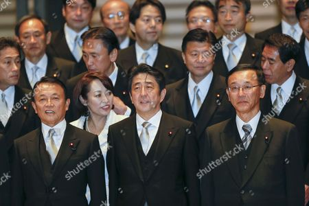 Newly Appointed Japanese Prime Minister Shinzo Abe (c) Smiles During a Photo Session at the Imperial Palace with Former Prime Minister and Newly Appointed Finance Minister Taro Aso (l) and New Justice Minister Sadakazu Tanigaki (r) After Being Attested by Emperor Akihito in Tokyo Japan 26 December 2012 Japan Tokyo