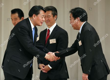 Former Trade Minister Banri Kaieda (l) Shakes Hands with Prime Minister Yoshihiko Noda (r) After Being Appointed As New President of the Democratic Party of Japan in the Party's Presidential Election in Tokyo Japan 25 December 2012 After Prime Minister Yoshihiko Noda Resigned Due to the Liberal Democratic Party's Landslide Victory in the Lower House Election December 16 Kaieda 63 Beat Contender Sumio Mabuchi (c Rear) in the Presidential Election Japan Tokyo