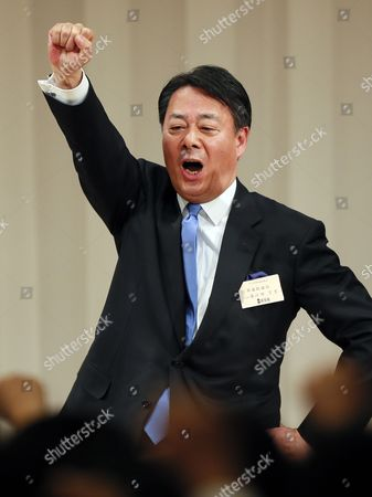 Former Trade Minister Banri Kaieda Raises His Fist and Shouts Slogans After Being Appointed As New President of the Democratic Party of Japan in the Party's Presidential Election in Tokyo Japan 25 December 2012 After Prime Minister Yoshihiko Noda Expressed His Resignation Due to the Liberal Democratic Parrty's Landslide Victory in the Lower House Election December 16 Kaieda 63 Beat Contender Sumio Mabuchi in the Presidential Election Japan Tokyo