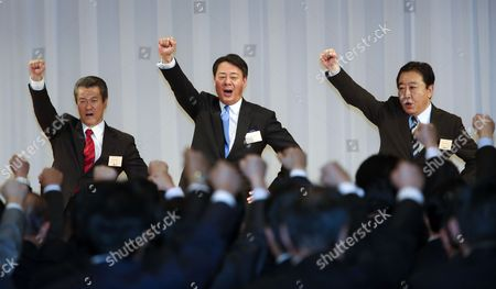 Former Trade Minister Banri Kaieda Raises His Fist and Shouts Slogan with His Contender Sumio Mabuchi (l) and Prime Minister Yoshihiko Noda (r) After Being Appointed As New President of the Democratic Party of Japan in the Party's Presidential Election in Tokyo Japan 25 December 2012 After Prime Minister Yoshihiko Noda Expressed His Resignation Due to the Liberal Democratic Parrty's Landslide Victory in the Lower House Election December 16 Kaieda 63 Beat Contender Sumio Mabuchi in the Presidential Election Japan Tokyo