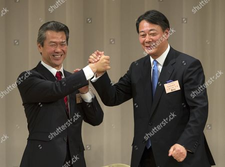 Former Trade Minister Banri Kaieda and Contender Sumio Mabuchi (l) Raise Their Arms After Delivering Their Speech Prior to the Presidential Election of the Democratic Party of Japan in Tokyo Japan 25 December 2012 After Prime Minister Yoshihiko Noda Expressed His Resignation Due to the Liberal Democratic Parrty's Landslide Victory in the Lower House Election December 16 Kaieda 63 Beat Mabuchi in the Presidential Election Japan Tokyo