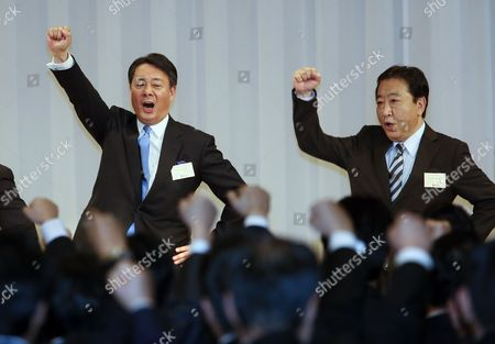 Former Trade Minister Banri Kaieda Raises His Fist and Shouts Slogan with Prime Minister Yoshihiko Noda (r) After Being Appointed As New President of the Democratic Party of Japan in the Party's Presidential Election in Tokyo Japan 25 December 2012 After Prime Minister Yoshihiko Noda Expressed His Resignation Due to the Liberal Democratic Parrty's Landslide Victory in the Lower House Election December 16 Kaieda 63 Beat Contender Sumio Mabuchi in the Presidential Election Japan Tokyo