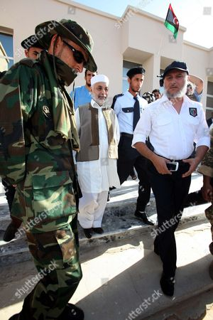 Former Libyan Prime Minister Baghdadi Al-mahmoudi (c) Outside the Courthouse on the First Day of His Trial in Tripoli Libya 12 November 2012 Al-mahmoudi is Accused of Involvement in Crimes During the Reign of Colonel Muammar Gaddafi Which was Toppled in 2011 He Served As Prime Minister From 2006 Until August 2011 Libyan Arab Jamahiriya Tripoli