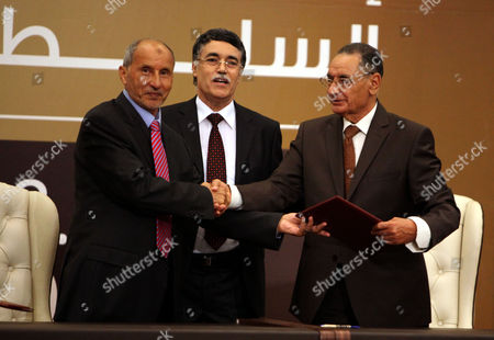 Libya's National Transitional Council (tnc) Chairman Mustafa Abdel Jalil (l) Kamal Edhan the President of the Supreme Court in Libya (c) and Mohammad Ali Sulayem Chairman of the National Conference (r) During the Transfer of Authority Ceremony in Tripoli Libya Early 09 August 2012 Libya's National Transitional Council Transferred Power to the Recently Elected National Congress Nearly a Year After the Ousting of Libyan Leader Moamer Gaddafi the Ceremony Started Shortly After Midnight with a Moment of Silence For Those who Fell During Libya's Uprising Followed by a Speech by the Head of the Ntc Mustapha Abdel Jalil who Called It a Historical Moment in the History of Libya Libyan Arab Jamahiriya Tripoli