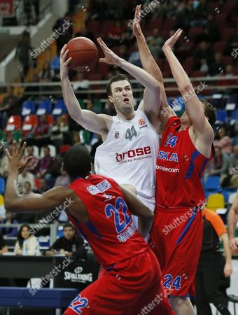 Dionte Christmas (l) and Sasha Kaun (r) of Cska Moscow Fights For the Ball with Andrew James Ogilvy (c) of Brose Baskets Bamberg During Their Euroleague Basketball Match in Moscow Russia 10 January 2013 Russian Federation Moscow