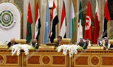 Front Row Arab League Secretary General Nabil Al-arabi (l) Egyptian President Mohamed Morsi (c) and Saudi Arabia's Crown Prince Salman Bin Abdul Aziz Al-saud (r) Attend the Opening Session of the Arab Economic Social Development Summit in Riyadh Saudi Arabia 21 January 2013 Arab Leaders Opened a Summit in Riyadh on 21 January Evening That was Set to Focus on Raising Trade and Investment and Address Recent Social and Political Upheaval Across the Region the Two-day Arab Economic Social Development Summit was Also to Debate New Rail Links Measures Toward Creating a Customs Union by 2015 and Ways to Combat Unemployment in the Arab World Saudi Arabia Riyadh