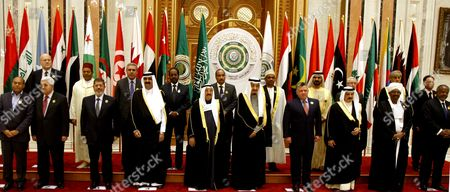 Arab Leaders (front L-r) Tunisian President Moncef Marzouki Palestinian President Mahmoud Abbas Egyptian President Mohamed Morsi Qatari Emir Sheikh Hamad Bin Khalifa Al-thani Kuwaiti Emir Sheikh Sabah Al-ahmad Al-sabah Saudi Arabia's Crown Prince Salman Bin Abdul Aziz Al-saud Jordan's King Abdullah Ii Bahrain's King Sheikh Hamad Bin Isa Al-khalifa Sudanese President Omar Al-bashir Amongst Others Pose For a Family Photograph at the Opening of the Arab Economic Social Development Summit in Riyadh Saudi Arabia 21 January 2013 Arab Leaders Opened a Summit in Riyadh on 21 January Evening That was Set to Focus on Raising Trade and Investment and Address Recent Social and Political Upheaval Across the Region the Two-day Arab Economic Social Development Summit was Also to Debate New Rail Links Measures Toward Creating a Customs Union by 2015 and Ways to Combat Unemployment in the Arab World Saudi Arabia Riyadh