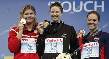 Gold Medalist Lauren Boyle (c) of New Zealand Silver Medalist Lotte Friss (l) of Denmark and Bronze Medalist Chloe Sutton (r) of the Us Pose During the Victory Ceremony of the 800 M Freestyle Women During the World Short Course Swimming Championships in Istanbul Turkey 13 December 2012 Turkey Istanbul