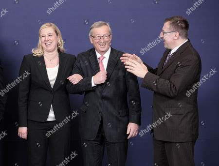 Stock Image of From L-r Finnish Finance Minister Jutta Urpilainen Jokes with President of the Eurogroup Luxembourg's Prime Minister Jean-claude Juncker and Belgian Finance Minister Steven Vanackere Prior to Posing For a Family Photo with Other Eurogroup Finance Ministers Prior to a Meeting at the Eu Headquarters in Brussels Belgium 21 January 2013 Belgium Brussels