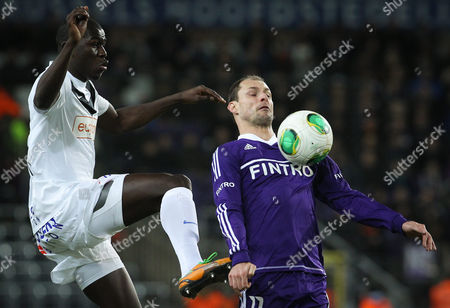 Genk's Kalidou Koulibaly (l) and Rsc Anderlecht's Milan Jovanovic (r) Fight For the Ball During the Semi-final of the Belgium Cup at the Constant Vanden Stock Stadium in Brussels Belgium 30 January 2012 Belgium Brussels