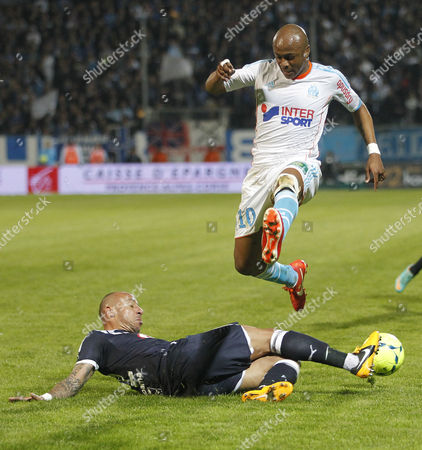 Andre Ayew (r) of Olympique Marseille Vies For the Ball with Julien Faubert (l) of Girondins Bordeaux During Their French Ligue One Match at the Velodrome Stadium in Marseille Southern France 05 April 2013 France Marseille