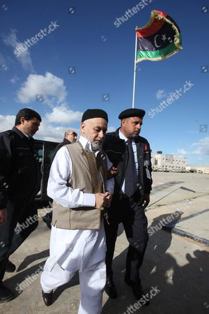 Former Libyan Prime Minister Baghdadi Al-mahmoudi (c) Arrives For the the Second Hearing of His Trial at a Courthousein Tripoli Libya 10 December 2012 Al-mahmoudi Faces Charges of Involvement in Crimes Under the Gaddafi Rule Which was Toppled Last Year He Served As Prime Minister From 2006 Until August 2011 when He Fled to Tunisia After Insurgents Seized Control of Tripoli Virtually Ending Gaddafis 42-year Rule Tunisia Extradited Al-mahmoudi to Libya in June 2012 Libyan Arab Jamahiriya Tripoli