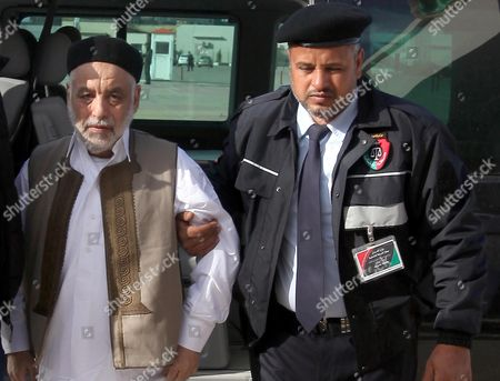 Former Libyan Prime Minister Baghdadi Al-mahmoudi (l) Arrives For the the Second Hearing of His Trial Outside a Courthouse in Tripoli Libya 10 December 2012 Al-mahmoudi Faces Charges of Involvement in Crimes Under the Gaddafi Rule Which was Toppled Last Year He Served As Prime Minister From 2006 Until August 2011 when He Fled to Tunisia After Insurgents Seized Control of Tripoli Virtually Ending Gaddafis 42-year Rule Tunisia Extradited Al-mahmoudi to Libya in June 2012 Libyan Arab Jamahiriya Tripoli