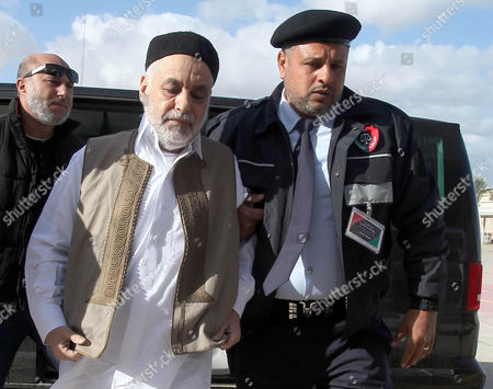 Former Libyan Prime Minister Baghdadi Al-mahmoudi (2-l) Arrives For the the Second Hearing of His Trial at a Courthouse in Tripoli Libya 10 December 2012 Al-mahmoudi Faces Charges of Involvement in Crimes Under the Gaddafi Rule Which was Toppled Last Year He Served As Prime Minister From 2006 Until August 2011 when He Fled to Tunisia After Insurgents Seized Control of Tripoli Virtually Ending Gaddafis 42-year Rule Tunisia Extradited Al-mahmoudi to Libya in June 2012 Libyan Arab Jamahiriya Tripoli