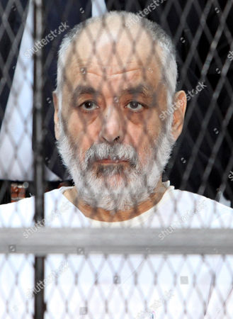 Former Libyan Prime Minister Baghdadi Al-mahmoudi Looks on As He Sits Behind Bars During the Fourth Hearing Session of His Trial at a Courthouse in Tripoli Libya 11 February 2013 Al-mahmoudi Faces Charges of Involvement in Crimes Under the Gaddafi Rule Which was Toppled in 2011 He Served As Prime Minister From 2006 Until August 2011 when He Fled to Tunisia After Insurgents Seized Control of Tripoli Virtually Ending Gaddafis 42-year Rule Tunisia Extradited Al-mahmoudi to Libya in June 2012 Libyan Arab Jamahiriya Tripoli