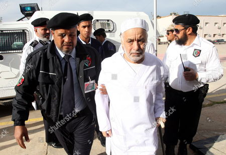 Former Libyan Prime Minister Baghdadi Al-mahmoudi (c) Arrives For the Third Hearing of His Trial at a Courthouse in Tripoli Libya 14 January 2013 Al-mahmoudi Faces Charges of Involvement in Crimes Under the Gaddafi Rule Which was Toppled in 2011 He Served As Prime Minister From 2006 Until August 2011 when He Fled to Tunisia After Insurgents Seized Control of Tripoli Virtually Ending Gaddafis 42-year Rule Tunisia Extradited Al-mahmoudi to Libya in June 2012 Libyan Arab Jamahiriya Tripoli