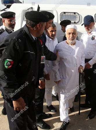 Former Libyan Prime Minister Baghdadi Al-mahmoudi (2-l) Arrives For the Third Hearing of His Trial at a Courthouse in Tripoli Libya 14 January 2013 Al-mahmoudi Faces Charges of Involvement in Crimes Under the Gaddafi Rule Which was Toppled in 2011 He Served As Prime Minister From 2006 Until August 2011 when He Fled to Tunisia After Insurgents Seized Control of Tripoli Virtually Ending Gaddafis 42-year Rule Tunisia Extradited Al-mahmoudi to Libya in June 2012 Libyan Arab Jamahiriya Tripoli