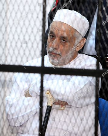 Former Libyan Prime Minister Baghdadi Al-mahmoudi Looks on As He Sits Behind Bars During the Third Hearing of His Trial at a Courthouse in Tripoli Libya 14 January 2013 Al-mahmoudi Faces Charges of Involvement in Crimes Under the Gaddafi Rule Which was Toppled in 2011 He Served As Prime Minister From 2006 Until August 2011 when He Fled to Tunisia After Insurgents Seized Control of Tripoli Virtually Ending Gaddafis 42-year Rule Tunisia Extradited Al-mahmoudi to Libya in June 2012 Libyan Arab Jamahiriya Tripoli