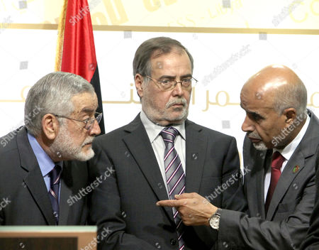 President of the Libyan General National Congress Mohamed Al-megaryef (r) First Deputy President of the National Congress Dr Juma Ahmed Ateega (c) Secretary General of the National Front For the Salvation of Libya Ibrahim Sahd (l) During a Media Conference on the Security Situation in Libya in Tripoli Libya 09 March 2013 Reports State That Hundreds of Protesters Gathered Outside the General Congress to Press Lawmakers to Vote in Favor of a Bill Banning Members of the Former Regime From Political Life Unknown Gunmen Opened Fire at Al- Megaryef Car While Leaving the Building But He Left Unharmed Epa/sabri Elmhedwi Libyan Arab Jamahiriya Tripoli