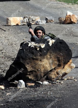 Stock Image of An Israeli Soldier Takes Up Position During the Weekly Protest Against the Jewish Settlement of Qadomem Near Nablus West Bank 08 February 2013 Israel's Outgoing Deputy Prime Minister Dan Meridor on 07 February 2013 Criticized the Government's Settlement Policy Saying Its Refusal to Limit Construction in the West Bank Contradicted the Claim That It Supports a Two-state Solution - Nablus