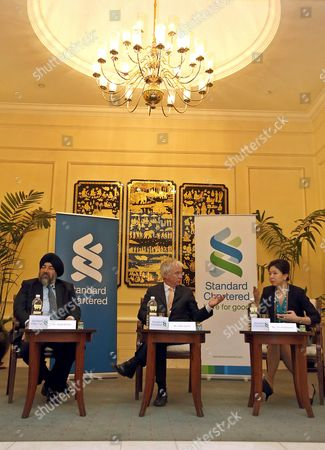 Peter Sands (c) Group Chief Exective Talks to the Media As Jaspal Bindra (l) Group Exective Director and Chief Exective Officer Asia and Tina Singhsacha (r) Chief Representative of Standard Chartered Bank in Myanmar Attend a Media Briefing at a Hotel in Yangon Myanmar 05 February 2013 Standard Chartered Bank Has Officially Re-opened Its Representative Office in Yangon According to the Bank's Press Release Standard Chartered Has Had a History of Over 150 Years with Myanmar Its History Extends Back to 1862 when the Bank Opened Its First Branch in Yangon This Operation was Nationalized in 1963 It Also Operated a Representative Office in Myanmar From 1995-2004 Myanmar Yangon