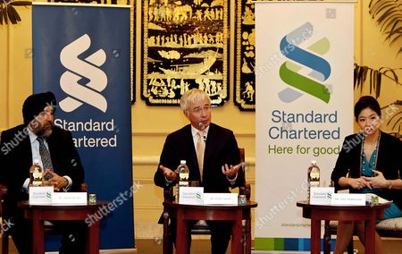 Stock Photo of Peter Sands (c) Group Chief Exective Talks to the Media As Jaspal Bindra (l) Group Exective Director and Chief Exective Officer Asia and Tina Singhsacha (r) Chief Representative of Standard Chartered Bank in Myanmar Attend a Media Briefing at a Hotel in Yangon Myanmar 05 February 2013 Standard Chartered Bank Has Officially Re-opened Its Representative Office in Yangon According to the Bank's Press Release Standard Chartered Has Had a History of Over 150 Years with Myanmar Its History Extends Back to 1862 when the Bank Opened Its First Branch in Yangon This Operation was Nationalized in 1963 It Also Operated a Representative Office in Myanmar From 1995-2004 Myanmar Yangon