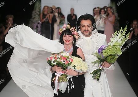 Designer Elena Souproun (l) Appears on a Catwalk with Russian Singer Philipp Kirkorov (r) During the 2013/2014 Fall/winter Mercedes-benz Fashion Week in Moscow Russia 01 April 2013 Russian Federation Moscow