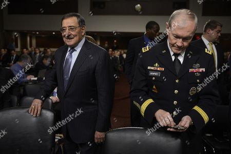 Stock Picture of Us Secretary of Defense Leon Panetta (l) and Chairman of the Joint Chiefs of Staff General Martin E Dempsey (r) Take Their Seats to Testify Before a Senate Armed Services Committee Hearing on the Defense Department's Response to the 11 September 2012 Attack on Us Facilities in Benghazi Libya on Capitol Hill in Washington Dc Usa 07 February 2013 United States Washington