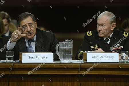 Stock Image of Us Secretary of Defense Leon Panetta (l) and Chairman of the Joint Chiefs of Staff General Martin E Dempsey (r) Testify Before the Senate Armed Services Committee Hearing on the Defense Department's Response to the 11 September 2012 Attack on Us Facilities in Benghazi Libya on Capitol Hill in Washington Dc Usa 07 February 2013 United States Washington