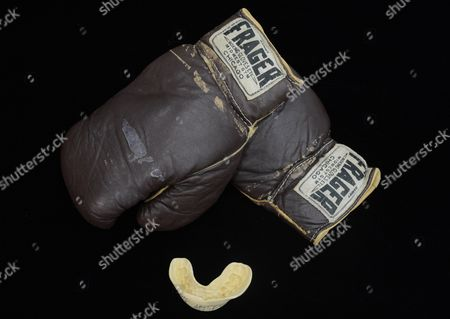Stock Picture of The Pair of Gloves of Muhammad Ali (then Cassius Clay) Worn in His 25 February 1964 Bout Against Sonny Liston and Ali's Mouthpiece From His Last Fight Items of a Collection of Boxing Memorabilia of Hall of Fame Trainer Angelo Dundee on Display at the National Sports Collectors Convention in Baltimore Maryland Usa 01 August 2012 the Angelo Dundee Estate Collection of Boxing Memorabilia Will Be Available in an Online Auction by Scp Auctions November 2012 Renowned Trainer Angelo Dundee was a Guiding Force to the Two Most Celebrated Fighters of His Era Muhammad Ali and Sugar Ray Leonard and Fifteen Other World Champions United States Baltimore