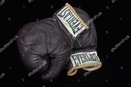 Stock Image of The Pair of Gloves of Muhammad Ali Worn in His 08 March 1971 Bout Against Joe Frazier an Item of a Collection of Boxing Memorabilia of Hall of Fame Trainer Angelo Dundee on Display at the National Sports Collectors Convention in Baltimore Maryland Usa 01 August 2012 the Angelo Dundee Estate Collection of Boxing Memorabilia Will Be Available in an Online Auction by Scp Auctions November 2012 Renowned Trainer Angelo Dundee was a Guiding Force to the Two Most Celebrated Fighters of His Era Muhammad Ali and Sugar Ray Leonard and Fifteen Other World Champions United States Baltimore