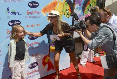 A Publicist Adjusts Child Actor Ian Patrick (l) As He is Photographed on the Red Carpet For the the Oogieloves in the Big Balloon Adventure Premiere in Hollywood California Usa 19 August 2012 United States Hollywood