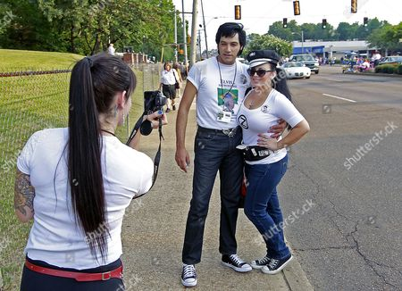 Stock Picture of Darlene Perez (r) Poses with Elvis Tribute Artist Mark Rio of Brazil As Thousands of Elvis Fans From Around the World Gather on the Street Outside Graceland the Home of Us Singer and Actor Elvis Presley in Memphis Tennessee Usa 15 August 2012 Elvis Known As the King of Rock N' Roll Died at the Mansion 35 Years Ago on 16 August 1977 United States Memphis