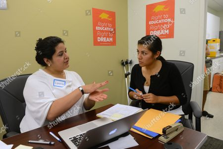 Policy Coordinator with United We Dream Lorella Praeli (l) Helps Bolivian-born Nataly Montano (r) Apply For the 'Consideration of Deferred Action For Childhood Arrivals' at the National Immigration Forum in Washington Dc Usa 15 August 2012 Beginning 15 August 2012 Hundreds of Thousands of Young People Across America Known As 'Dreamers' Became Eligible to Apply For Work Permits and Protection From Deportation Known As 'Deferred Action' Deferred Action Has Been Applauded by Obama Supporters But Falls Short of Congressional Passage of the Dream Act Say Immigration Advocates United States Washington