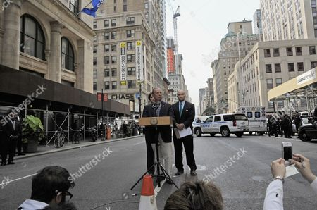 New York City Mayor Michael Bloomberg (c) Holds a Press Conference a Half Block From the Empire State Building where a 53-year-old Man who Had Been Sacked From an Apparel Company Shot and Killed a Former Co-worker in New York Usa 24 August 2012 Police Commissioner Raymond W Kelly (r) Said That Nine Bystanders Had Been ?wounded Or Grazed? and Taken to Hospitals the Mayor Said Said That Some of the Injured May Have Been Hit by Police Bullets During the Confrontation with the Suspect Whom Mr Kelly Identified As Jeffrey Johnson a Former Clothing Designer at Hazan Industries Epa/peter Foley United States New York