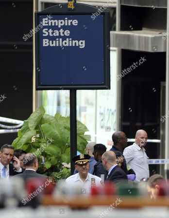 Stock Picture of New York City Police Crime Investigators Gather Outside the Empire State Building where a 53-year-old Man who Had Been Sacked From an Apparel Company Shot and Killed a Former Co-worker in New York Usa 24 August 2012 Police Commissioner Raymond W Kelly Said That Nine Bystanders Had Been 'Wounded Or Grazed' and Taken to Hospitals the Mayor Said Said That Some of the Injured May Have Been Hit by Police Bullets During the Confrontation with the Suspect Whom Mr Kelly Identified As Jeffrey Johnson a Former Clothing Designer at Hazan Industries United States New York