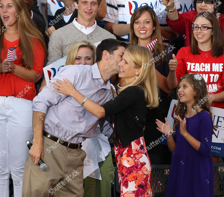 Republican Presidential Candidate Mitt Romney Vice Presidential Running Mate Wisconsin Congressman Paul Ryan (l) Kisses His Wife Janna Little During Waukesha Homecoming Rally at the Waukesha County Expo in Waukesha Wisconsin Usa 12 August 2012 United States Waukesha